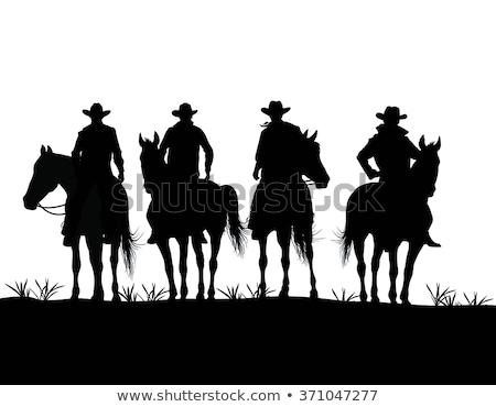 cowboy · sziluett · domb · naplemente · égbolt · város - stock fotó © mayboro