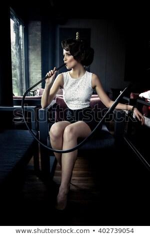 atractive woman smoking water pipe stock photo © bananna