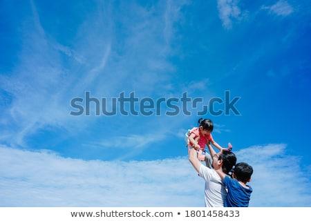 Father and son travelers in malaysia with malaysia flag celebrat Stock photo © galitskaya