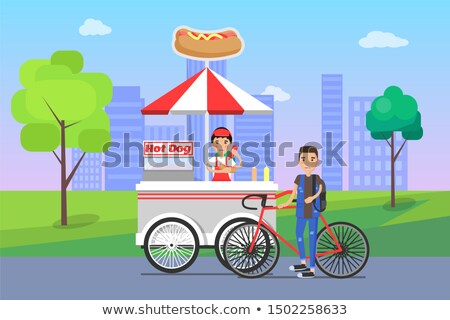 hot dog stall with snacks bicyclist by merchant stock photo © robuart