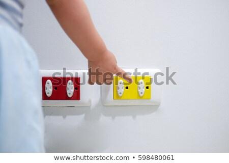 Kéz dugó foglalat közelkép gyerekek fal Stock fotó © AndreyPopov