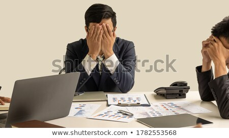 Stock photo: portrait of stressed business man with document graph in the off