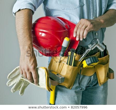 Arbeitnehmer Tool Gürtel tragen weiß Helm Stock foto © Lopolo