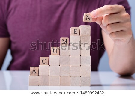 Human Hand Placing Last Alphabet Of Word Acumen Stock photo © AndreyPopov