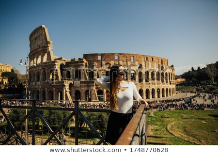 Happy Woman Looking At Colosseum Arena Stock photo © AndreyPopov