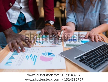 Hands of young multicultural employees over financial papers during discussion Stock photo © pressmaster