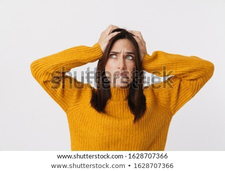 Image of stressed brunette adult woman frowning and grabbing her Stock photo © deandrobot