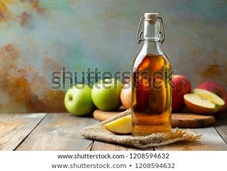 Botellas zumo de manzana vinagre mesa de madera frutas bebidas Foto stock © dolgachov
