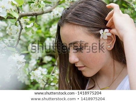 pretty girl with flowers in her hair Stock photo © OleksandrO