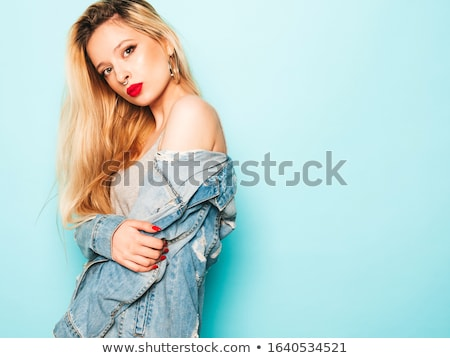 Portrait of sexy playful young woman stock photo © acidgrey