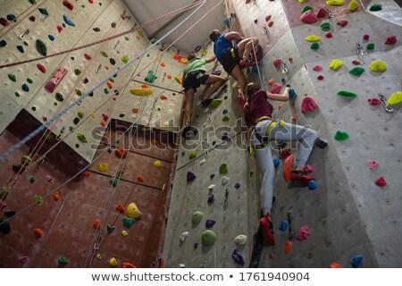 Treinador atletas parede escalada clube masculino Foto stock © wavebreak_media