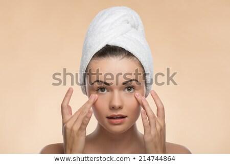 Young woman touching under the eye Stock photo © Kzenon