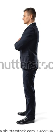 Stock photo: Side view of standing young Asian male executive looking at chart in modern office