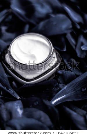 Luxury face cream moisturizer for facial skin on dark flower bac Stock photo © Anneleven
