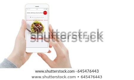 продовольствие обед онлайн смартфон женщину Сток-фото © galitskaya