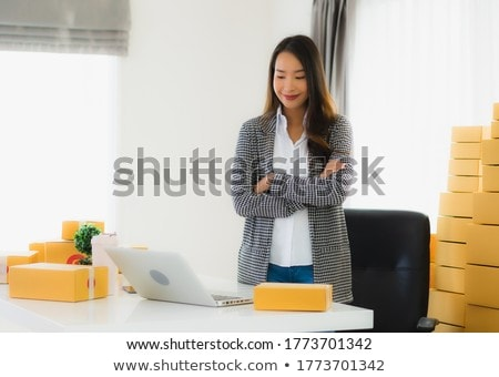 Portrait of a beautiful young businesswoman on the computer, rec Stock photo © HASLOO
