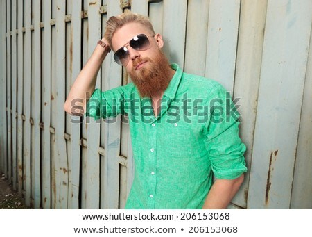 man passing  hand through his hair and looks to side Stock photo © feedough