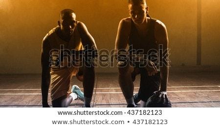Retrato rodilla piso mano pelota Foto stock © wavebreak_media