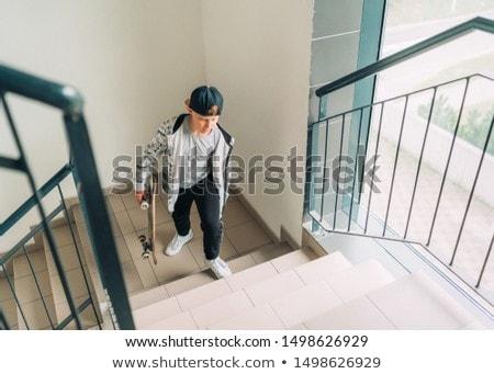Fiatal srác lépcsőfeljáró fiú férfi aranyos gyermekkor Stock fotó © IS2