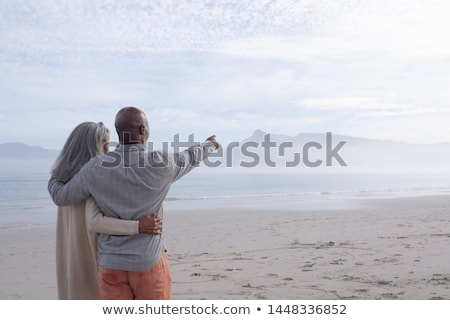 Rear view of senior black man standing on beach in the sunshine Stock photo © wavebreak_media