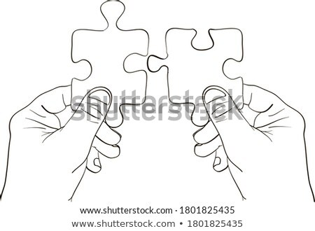 Two People Joining The Jigsaw Puzzles Stock photo © AndreyPopov