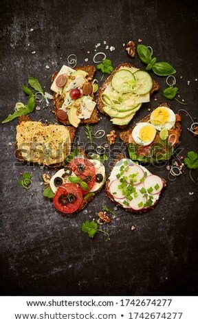 Healthy vegan sandwiches made from homemade buckwheat bread with various toppings Stock photo © dash