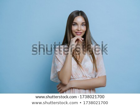 Waist up shot of pretty brunette European woman wears stylish summer dress, keeps hands partly cross Stock photo © vkstudio