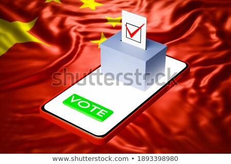 Man putting a ballot into a voting box - China Stock photo © Zerbor