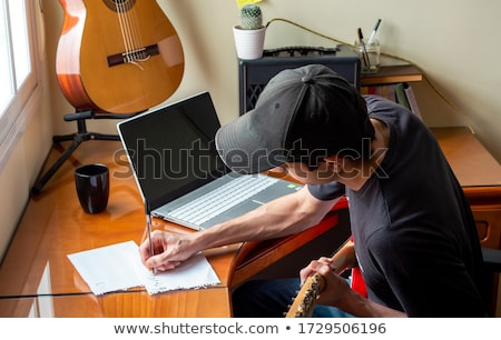 Concentrating on his electric guitar playing Stock photo © sumners