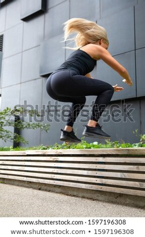 Fitness woman jumping outdoor in urban enviroment Stock photo © boggy