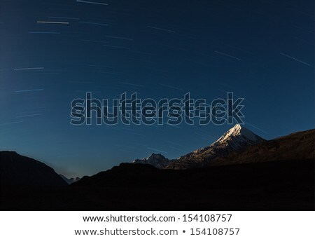Star trails above Himalayas mountains.  Stock photo © dmitry_rukhlenko