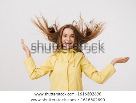 Fotó szép derűs nő esőkabát készít Stock fotó © deandrobot