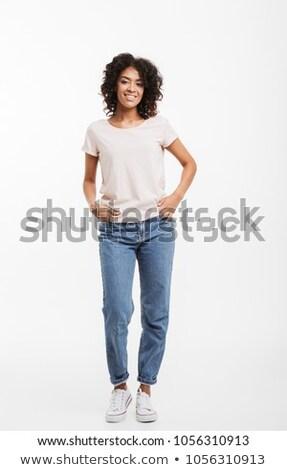portret · permanente · vrouw · jeans · vrouwen - stockfoto © phbcz