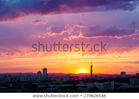 Fantástico dramático pôr do sol céu industrial cidade Foto stock © dariazu