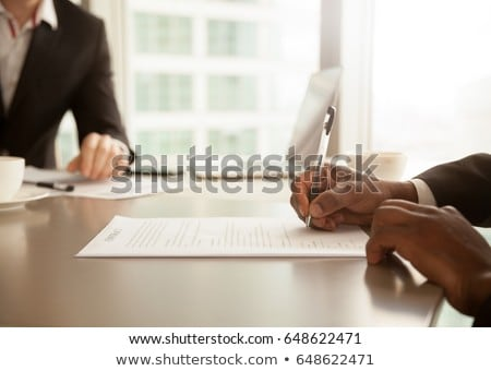 African businessmen sign a contract Stock photo © studioworkstock