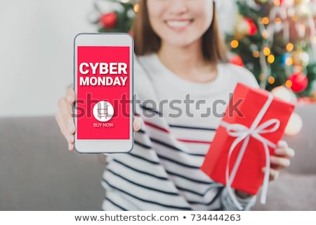 gift and text happy cyber monday in a smartphone Stock photo © nito