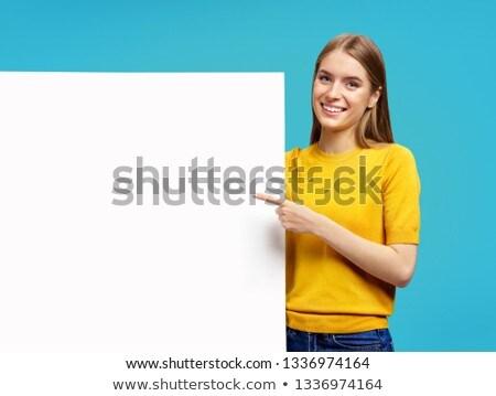 Stockfoto: Heldere · portret · wijzend · exemplaar · ruimte · studio · foto