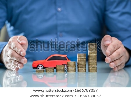 Man Protecting Red Car And Stacked Coins Stock photo © AndreyPopov