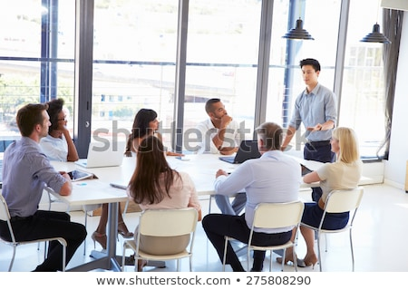 Side view of Multi-ethnic business people working on computer at desk in modern office Stock photo © wavebreak_media