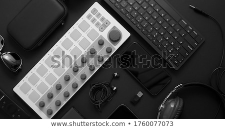 Audio producer concept. Various digital recording audio music gadgets placed on black background. Stock photo © dash