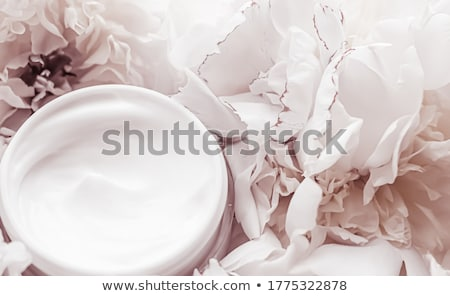 Luxe cosmetic cream jar as antiaging skincare routine product on background of peony flowers, body m Stock photo © Anneleven