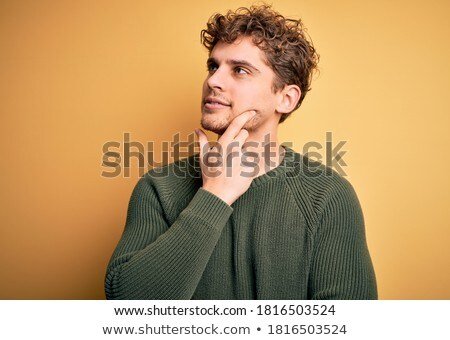 portrait of a handsome young man over green background stock photo © hasloo