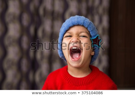 непослушный индийской ребенка мальчика улыбаясь прелестный Сток-фото © ziprashantzi