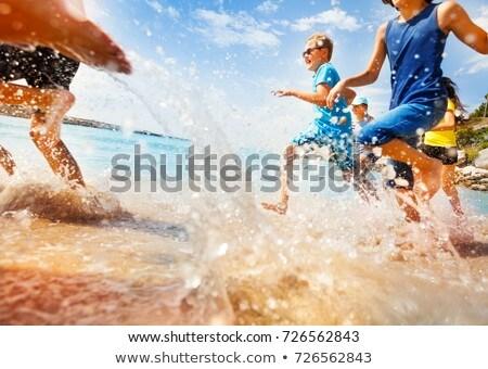 Jóképű tini jókedv úszik óceán kék ég Stock fotó © meinzahn