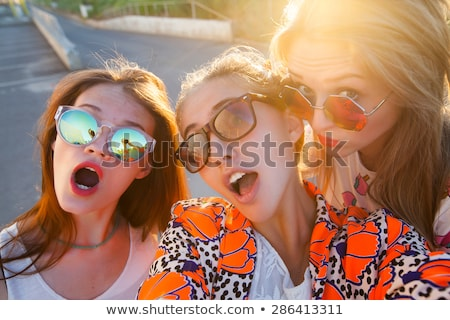 happy joyful man with sunglasses looking at summer icons stock photo © ra2studio