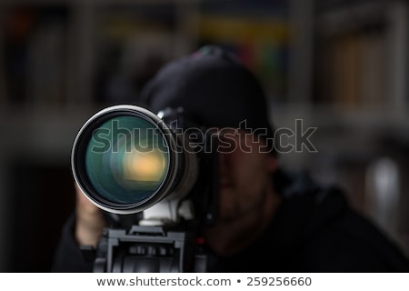 Closeup Lens of Camera with Secret. Stock photo © tashatuvango