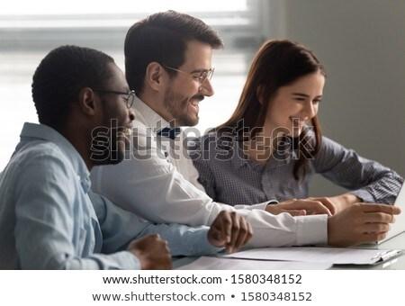 вид сбоку бизнеса коллеги сидят смотрят Сток-фото © wavebreak_media
