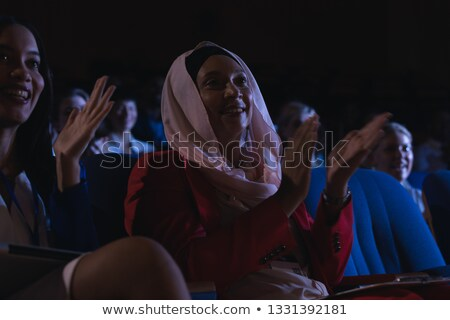 Low angle view of mixed race businesswoman sitting  and clapping in the auditorium  Stock photo © wavebreak_media