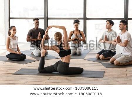 Vue arrière entraîneur enseignement exercice Photo stock © wavebreak_media