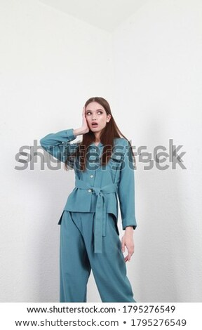 Portrait of cute young woman expressing surprised and looking aside Stock photo © deandrobot